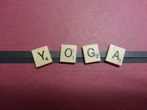 Yoga spelled with tiles Stock Images