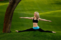 Yoga splits in the park Stock Photos