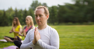 Yoga sportsmen in park - performs exercise outdoors outdoor at morning Royalty Free Stock Photo