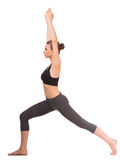 Yoga. Sporty young woman doing yoga exercise. Side view Stock Images