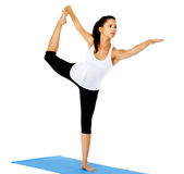 Yoga standing bow pulling pose Royalty Free Stock Image