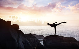 Yoga on the stones royalty free stock photography