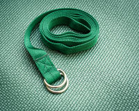 Yoga strap. On green exercise mat Royalty Free Stock Images