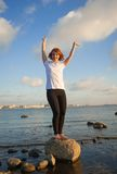 Yoga Stretch. Beautiful woman doing yoga exercises on the beach Royalty Free Stock Image