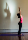 Yoga stretch with shadow stock photography