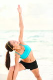 Yoga stretching woman on beach Stock Images