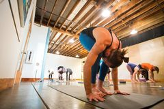 Yoga Studio Editorial. SPRINGFIELD, OR - MARCH 11, 2018: Advanced yogi and male yoga instructor Ben Wilkinson working out during a teaching class at Common Bond Royalty Free Stock Photography