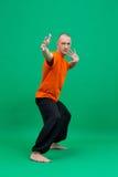Yoga. Studio photo of middle-aged man doing asana Royalty Free Stock Photos
