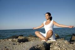 Yoga style at sea royalty free stock image