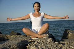 Yoga style at sea royalty free stock photography