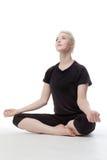 Yoga sul pavimento Immagini Stock
