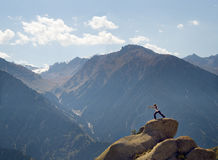 Yoga at summit. With aerial view of the mountain range Stock Photo