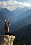 Yoga at summit. With aerial view of the mountain range and peak. Blue sky Royalty Free Stock Photography