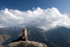 Yoga at summit. With aerial view of the mountain range and peak. Blue sky Royalty Free Stock Photos