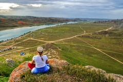 Yoga at summit. With aerial view of the river valley Royalty Free Stock Photography