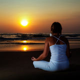 Yoga at sunrise time Stock Image