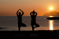 Yoga at sunset Stock Image
