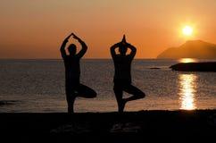 Yoga at sunset Stock Image