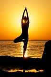 Yoga on sunset Stock Photos