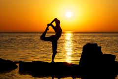 Yoga on sunset Royalty Free Stock Photography