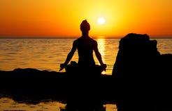 Yoga on sunset Stock Photos