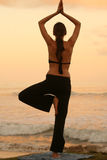 Yoga by sunset. Yoga exercises by sunset in the caribbean Stock Photo