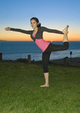Yoga at Sunset. Girl in yoga pose at sunset Stock Image