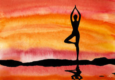 Yoga at sunset Stock Images