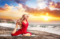 Yoga at sunset beach stock images