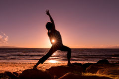 Yoga at Sunset on the Beach Royalty Free Stock Image