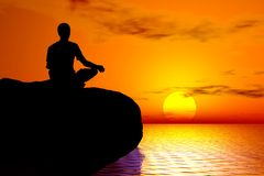 Yoga - Sunset meditation. Young boy in meditation position practising yoga Royalty Free Stock Photo