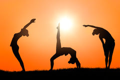 Yoga at sunset Royalty Free Stock Photography