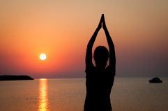 Yoga at sunset Royalty Free Stock Images
