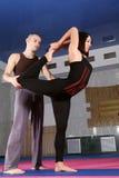 Yoga teacher corrected yoga pose Royalty Free Stock Photo