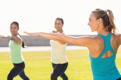 Yoga teacher and sporty women attending yoga class Stock Images