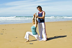 Yoga teacher teaches student yoga Stock Photo