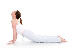 Yoga Time. Beautiful woman doing yoga on isolated white background Royalty Free Stock Photo