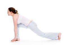 Yoga Time. Beautiful woman doing yoga on isolated white background Stock Photo