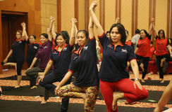 Yoga together. Hotel employees doing yoga together in the ballroom of this activity is one way of maintaining physical fitness and health, Surakarta, Central royalty free stock photography