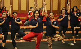 Yoga together. Hotel employees doing yoga together in the ballroom of this activity is one way of maintaining physical fitness and health, Surakarta, Central royalty free stock images