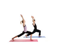 Yoga and Togetherness. Young Couple Doing Yoga Together on a white background Royalty Free Stock Images
