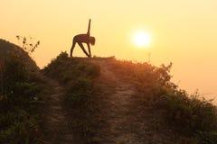 Yoga on the top mountain Stock Photo