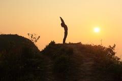 Yoga on the top mountain Royalty Free Stock Photo