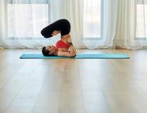 Yoga trainer in asana Royalty Free Stock Image