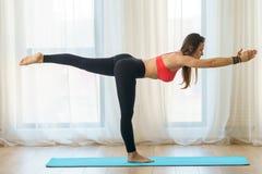 Yoga trainer in asana Royalty Free Stock Photography