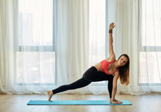 Yoga trainer in asana Royalty Free Stock Photography