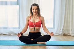Yoga trainer in asana. Woman yoga trainer in various postures asanas in a studio Royalty Free Stock Photography