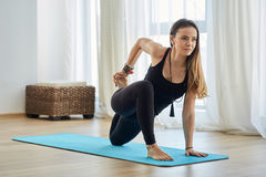 Yoga trainer in asana Stock Images