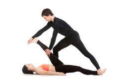 Yoga with trainer Stock Photography