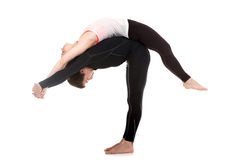 Yoga with trainer Stock Image